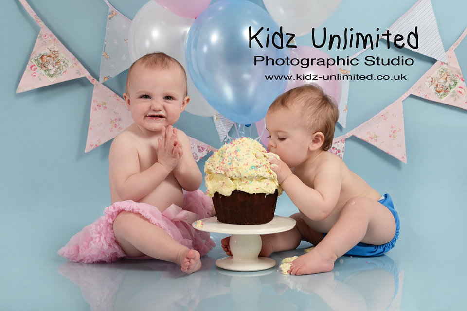 Birthday Twin Babies with cake in Baby Photo Shoot in Thanet, Kent