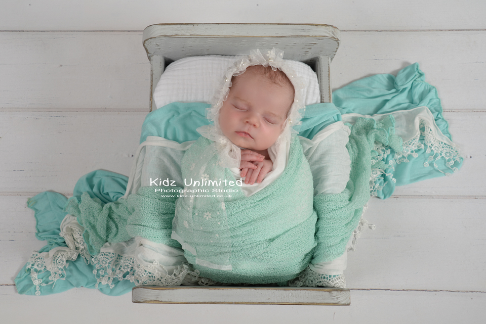 Newborn baby girl in mint and white by Thanet Photographer